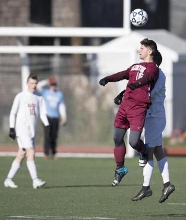 Lynn, MA - 11/10/2017 - Arlington High School #16 Will Clifford heads the soccer ball. (John Cetrino for The Boston Globe) SPORTS Logan Mullen Reporter