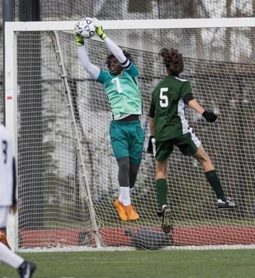 Lynn, MA - 11/12/2017 - Boston International keeper Helder Vaz-Depina with a save vs Manchester Essex #5 Addi Strack (right) (John Cetrino for The Boston Globe) Sports Reporter Jonathan Sigal