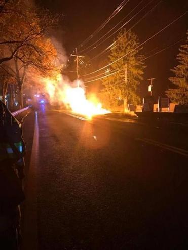 Downed power lines burning on Route 20 in Wayland Monday night.
