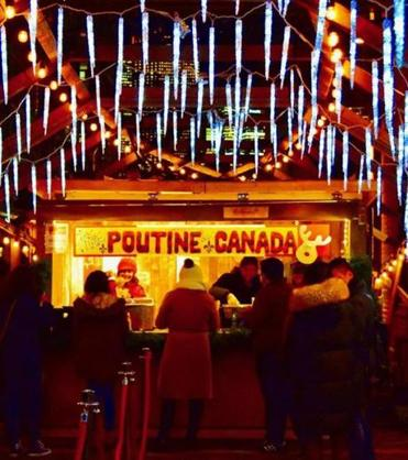 Customers line up for poutine at the Toronto Christmas Market in the Distillery District, Toronto.