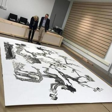 Mary Schneider Enriquez, the Harvard Art Museums curator of Modern and Contemporary Art, and Edouard Kopp, the curator of drawings, were in Somerville with Kara Walker's piece last month to discuss the installation.