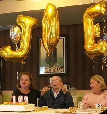 Joe Bach celebrates his 109th birthday with his daughters, Anita Bloch (left) and Naomi Fayman. (Leonard Florence Center for Living)