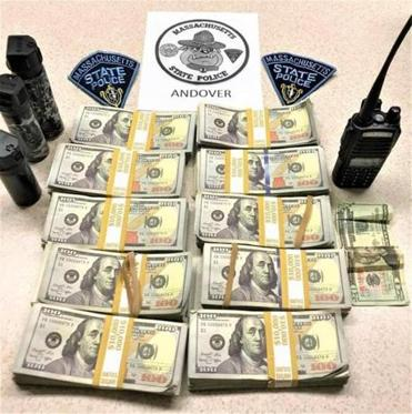 State Police recovered bundles of counterfeit cash, along with three cans of pepper spray and a handheld radio, from an Acura that was outfitted with flashing blue lights.