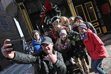 Boston, Ma., 12/29/17, Jason Rose, of Bow, NH, takes a photo in front of the Green Dragon. Three pubs lay claim to the oldest in Boston -- the Warren Tavern in Charlestown, and the Bell in Hand and the Green Dragon near Haymarket. Suzanne Kreiter/Globe staff