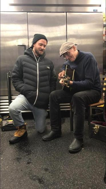 Justin Timberlake and James Taylor play a duet in the kitchen at a party in Big Sky, Montana.