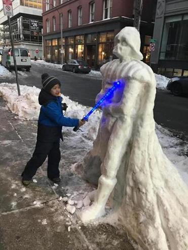 George Li carved a Darth Vader snowman for his son, Tanner, on a sidewalk in the Leather District. On Wednesday morning, Tanner confronted the icy villain.