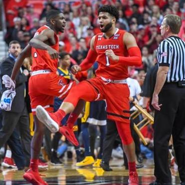 zLUBBOCK, TX - JANUARY 13: Brandone Francis #1 of the Texas Tech Red Raiders and Josh Webster #3 of the Texas Tech Red Raiders celebrate at a timeout during the game against the West Virginia Mountaineers on January 13, 2018 at United Supermarket Arena in Lubbock, Texas. (Photo by John Weast/Getty Images)