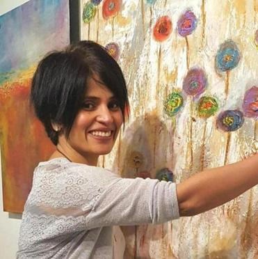 Software developer/artist Chaya Mallavaram sells her Chartzie Art Scarves at local boutiques.