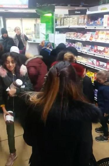 In this image taken from a video, customers rush to carry away pots of Nutella in a Toulon, France, supermarket.