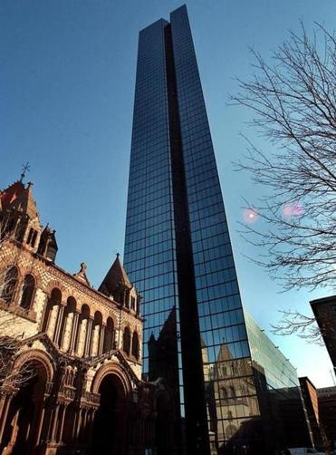 """We need to restore the profile we had in the Hancock [Tower],"" said Dick DeWolfe, Manulife chairman and Boston real estate executive."