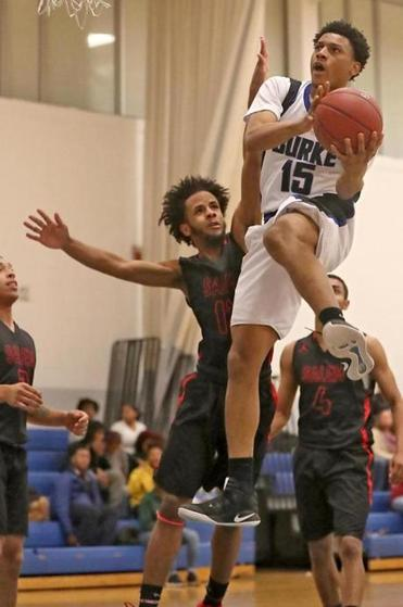 Burke's McCarthy Akinkouye drove to the basket for two of his 20 points against Salem.