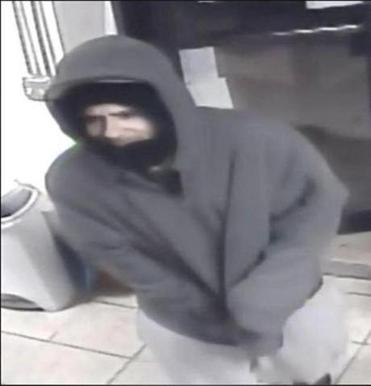 Fall River police are searching for a masked man who robbed a store at gunpoint.