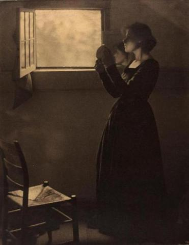 """Girl With Mirror"" is among the photographs in ""Clarence H. White and His World."""