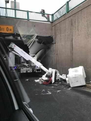 A bucket truck smacked into North Harvard Street Bridge on Soldiers Field Road on Wednesday morning because it was overheight.