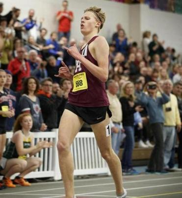 2/24/2018 - Boston, MA - Reggie Lewis Center - Two-mile first-place finisher Ryan Oosting, cq, a junior at Arlington High school broke a national record with his win. Hundreds of track and field athletes competed in the 33rd Annual MIAA Indoor Track & Field All-State Championship at the Reggie Lewis Track in Boston on Saturday, February 24, 2018. Topic: 8.4.1095585097. Story by Shawn Mcfarland. Photo by Dina Rudick/Globe Staff