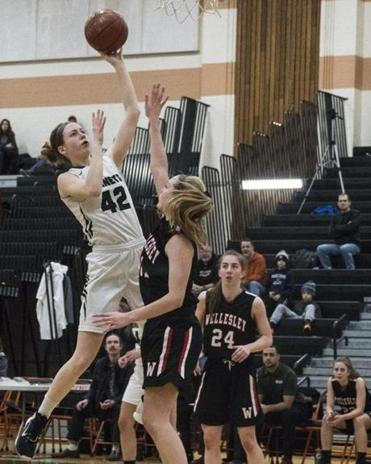 8.4.1172127202_Sports_04schhoop Mansfield High's Margaret Danehy (42) goes high over Wellesley High defender Emma Dougherty (11) during the Division 1 South quarterfinals round girls' basketball game game at Taunton High School in Taunton, Mass., Saturday, March. 3, 2018. (Robert E. Klein for the Boston Globe)
