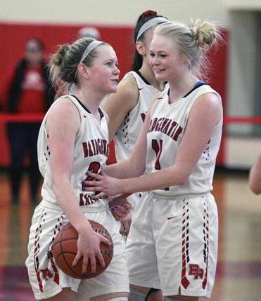Bridgewater-Raynham junior Kaleigh Matulonis offers an encouraging word to her younger sister, Kenzie, a freshman, before she heads to the line for a foul shot late in the game.