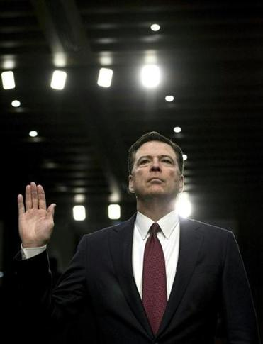 James Comey, the fired FBI director, shown at a Senate Select Committee hearing last June, will now appear on Stephen Colbert's late-night TV show.