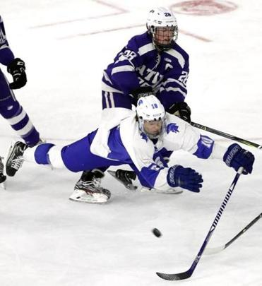 Stoneham's Nick Feliciano is dumped by Boston Latin's Frank Linso during their D2 North Final hockey game in lowell, Mass., Sunday, March 11, 2018. (Winslow Townson for The Boston Globe)