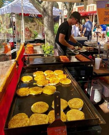 Gaby Carrillo and Luis Sosa's TocToc Arepas on the griddle.