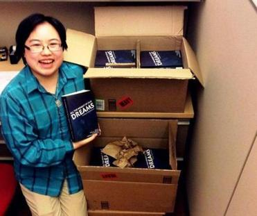 "Lydia X. Z. Brown with copies of ""All the Weight of Our Dreams,"" the first-ever anthology of writings and artwork by autistic people of color. (Lydia X. Z. Brown)"