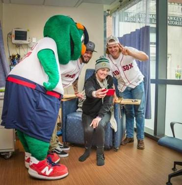 From left: Wally the Green Monster, Blake Swihart, Maggie, and Brock Holt at the Jimmy Fund Clinic.