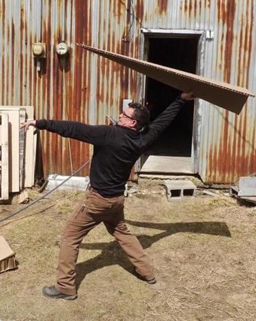 Artist Jack Welch tested a cardboard airplane at Fitchburg Municipal Airport.