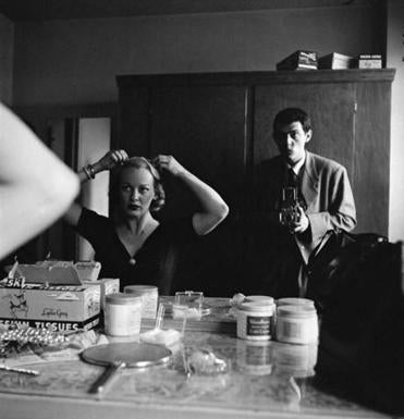 Stanley Kubrick in 1950, as seen in a picture the then-photojournalist took of actress Faye Emerson looking in a mirror and fixing her hair.