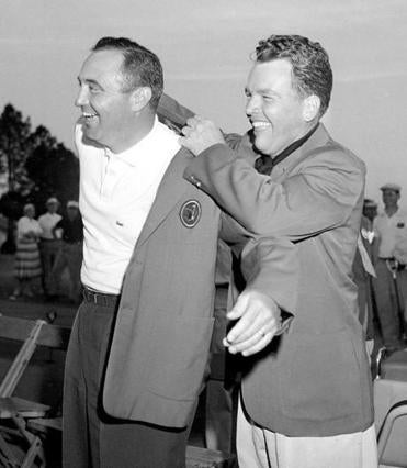 In 1957, Mr. Ford got a hand from Jack Burke Jr. as he donned the green jacket worn by Masters' winners.