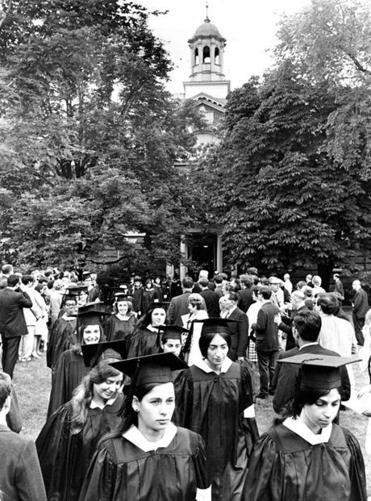 Radcliffe College seniors passed the college towers on their way to 1968 commencement exercises. Radcliffe students faced strict rules about interacting with those at Harvard.