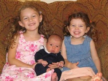 Alexandra (left) with her infant brother, Nicholas, and sister Emily.