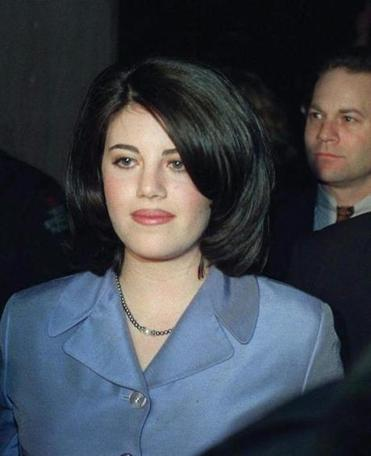Monica Lewinsky and her attorney William Ginsburg, rightt, leave a Washington restaurant Saturday night, Feb. 21, 1998. Despite protests from an associate that she was a virtual prisoner of circumsance, Lewinsky did manage to slip out for dinner--in a private dining room--Saturday evening at a steakhouse a few blocks from the White House. (AP Photo/Charles Rex Arbogast) USED AS HEADSHOT OF MONICA LEWINSKY 03/17/98 -- Library Tag 01202001 National-Foreign