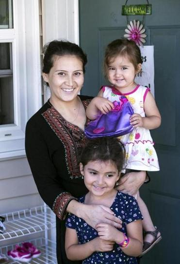 Safiya Wazir and her daughters Aaliyah, 2, and Mahwash outside their home in Concord, N.H.