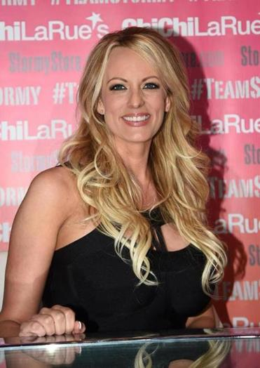 "(FILES) In this file photo taken on May 23, 2018 adult film star Stormy Daniels poses and signs autographs at Chi Chi Larue's adult entertainment store in West Hollywood, California. - Adult film star Stormy Daniels said September 12, 2018 she will publish an autobiography detailing her alleged affair with President Donald Trump in October, shortly before key US midterm elections. Daniels, who says she had an affair with Trump in 2006, around the time that the reality television star's wife Melania had given birth to their son Barron, said she would dedicate the tell-all -- entitled ""Full Disclosure"" -- to her young daughter. (Photo by Robyn Beck / AFP)ROBYN BECK/AFP/Getty Images"