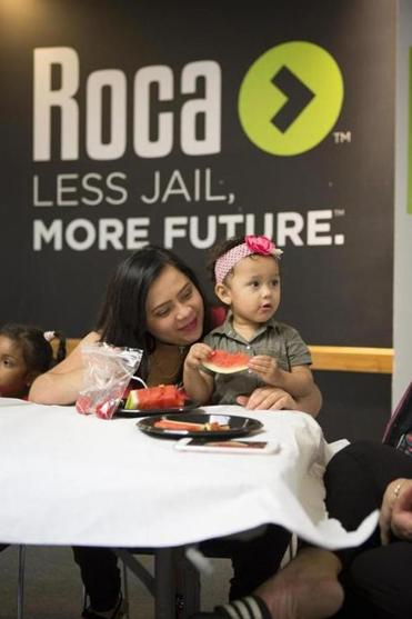 30noinformer - Roca, which will celebrate its 30th anniversary on Oct. 30, hosts weekly family night dinners for the Roca Young Mothers Program. (John Soares/Roca)