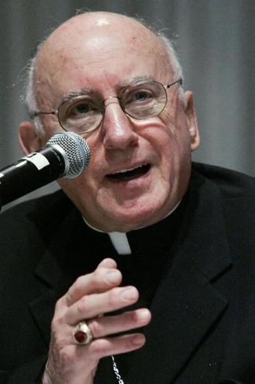 Archbishop Harry Flynn of St. Paul, Minn., answers questions on policies dealing with allegations of sexual abuse of minors during a news conference Friday, June 17, 2005, at the U.S. Conference of Catholic Bishops spring general meeting in Chicago. (AP Photo/Charles Rex Arbogast)