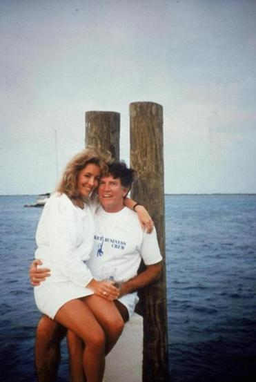 Model Donna Rice sitting on Gary Hart's lap on a Florida dock in the infamous National Enquirer photo.