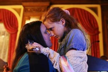 Boston, MA - 11/06/2018- ] Jodi, 41, and her transgender daughter Lia, 10 embrace as they wait for polling results to finalize at a Yes on 3 campaign watch party at the Fairmont on Tuesday, November 6, 2018. NOTE: Subjects ask their last names not be used. (Michael Swensen for The Boston Globe) Topic: (metro)