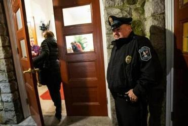 11/21/2018 LEXINGTON, MA Lexington Police Officer Mike Barry (cq) was posted at the entrance during an interfaith service held at Hancock United Church Of Christ in Lexington. Hancock United Church of Christ felt that armed security was needed for an interfaith service in the wake of the Pittsburgh shootings. First time -- ever -- that the church has hired armed security. (Aram Boghosian for The Boston Globe)