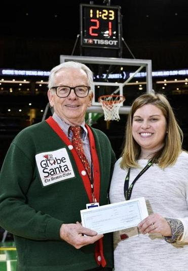 Globe Santa's Bill Connolly accepts a $1,000 check from TD Garden Community Affairs Manager Courtney DiSano.
