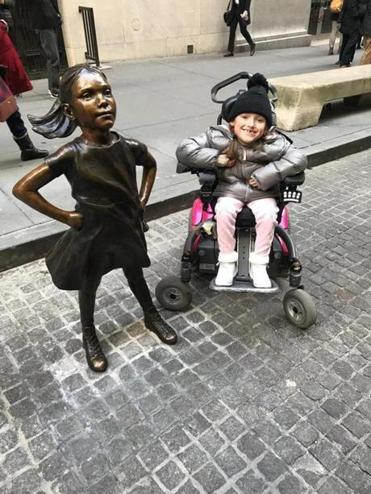 "Harper Oates smiled widely next to ""Fearless Girl"" on Monday."