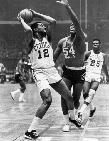 Mr. Naulls was guarded by Philadelphia 76ers player Lucious Jackson during a game in Boston on Jan. 16, 1966.