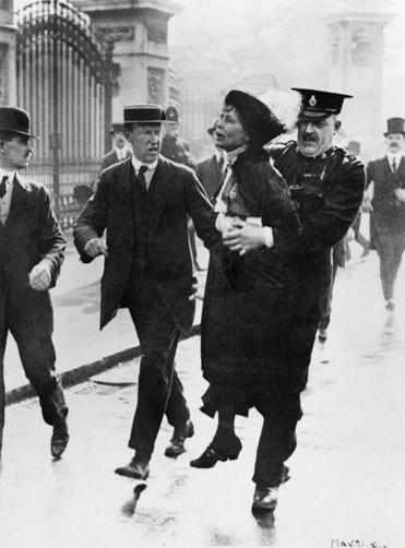 Mrs Emmeline Pankhurst, Leader of the Women's Suffragette movement, is arrested outside Buckingham Palace while trying to present a petition to King George V in May 1914. The leader of the Women's Suffragette movement, Mrs Emmeline Pankhurst is arrested by Superintendant Rolfe outside Buckingham Palace, London while trying to present a petition to HM King George V in May 1914.