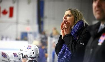 Methuen/Tewksbury girls' hockey coach Sarah Oteri shouted encouragement to her overworked penalty killers.