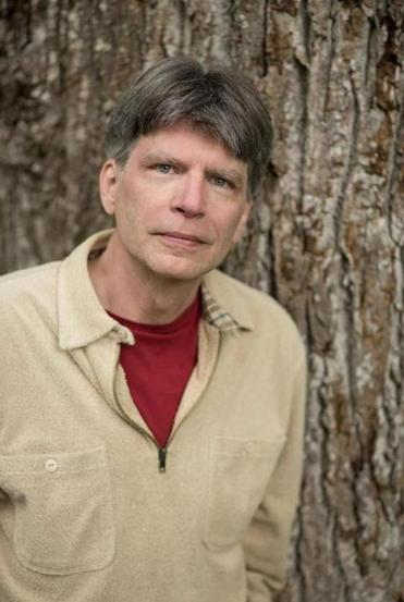 Richard Powers went to the forest to write, and stayed
