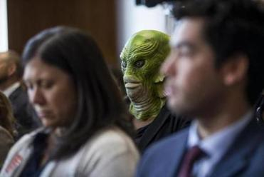WASHINGTON, DC - MARCH 28: A demonstrator wearing a Creature of the Black Lagoon mask like David Bernhardt, President Donald Trump's nominee to be Internal Secretary, testified during a hearing confirming the Senate Energy and Natural Resources Committee on 28  t March, 2019 in Washington, DC. (Photo by Zach Gibson / Getty Images)