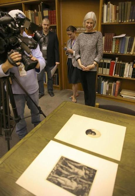 Amy Ryan (right) looked over the found art in the rare books room.