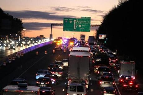 1/12/16, MA - -LEXINGTON,MA - Overpass over Rt 128 (95) in Lexington looking at traffic northbound backed up before the Rt 3 exit in Burlington after an early morning accident of driver going wrong way. (globe staff photo: Joanne Rathe reporter: topic: section: METRO)