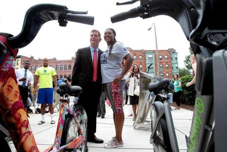 Mayor Martin Walsh and Michelle Cook, founder of Roxbury Rides, celebrated the new Hubway station outside the Roxbury YMCA.