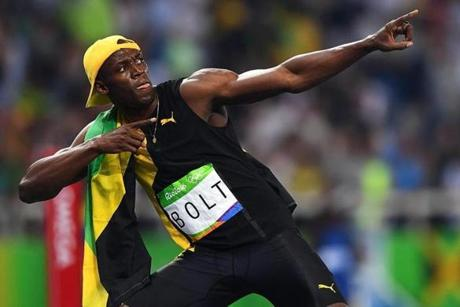 Usain Bolt of Jamaica celebrates after placing first and the gold medal in the men's 100m final race the Olympic Stadium.